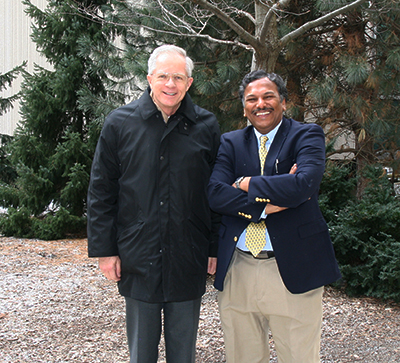 Profs Dravid and Howe, outside Cook Hall
