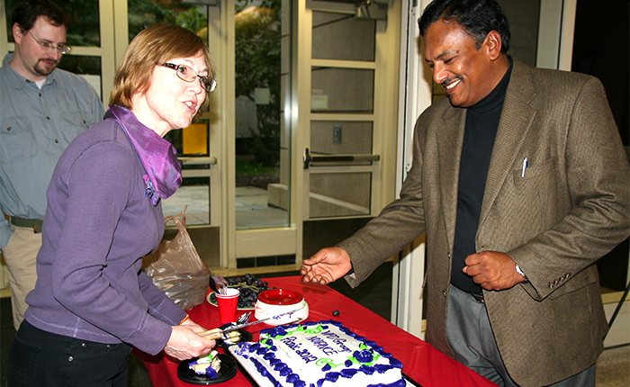 Mary Pat and Vinayak cut the cake