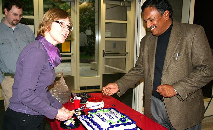Mary Pat and Vinayak cut the cake