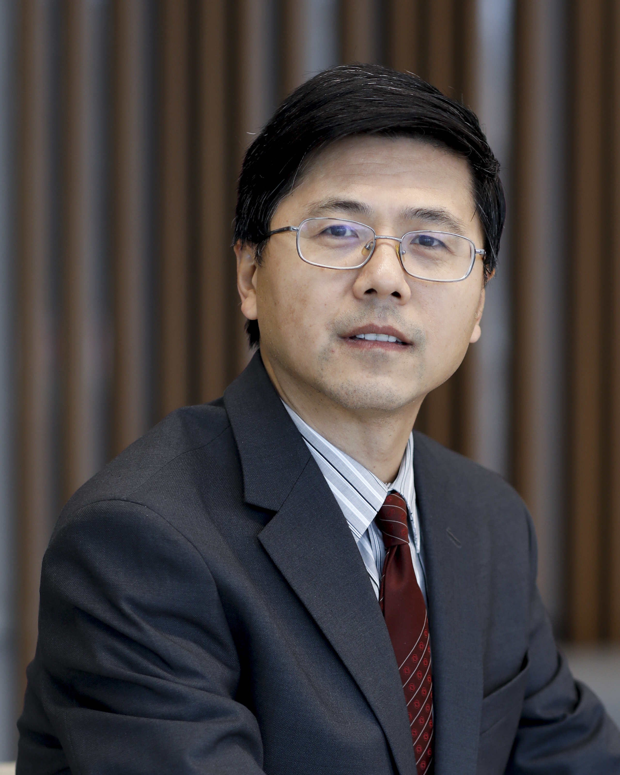 Dr. Xinqi Chen